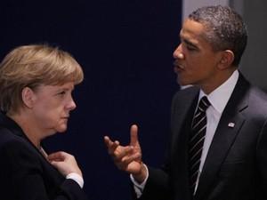 Россия, по мнению Обамы и Меркель, может стабилизировать ситуацию на востоке Украины